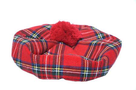 headgear: Traditional Scottish Bonnet, also named Tam o Shanter. Men headgear Isolated on white Background. Stock Photo