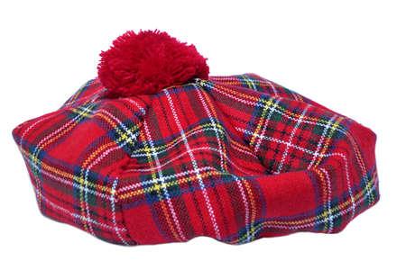 Traditional Scottish Bonnet, also named Tam o Shanter. Men headgear Isolated on white Background. Stock Photo