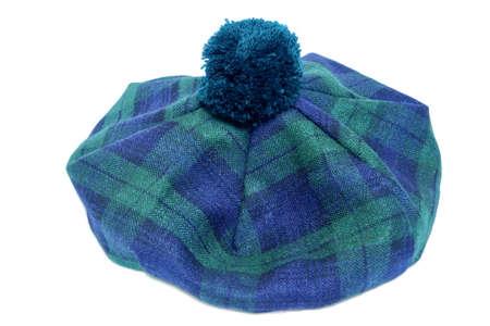 headgear: Traditional Scottish Green Tartan Bonnet, also named Tam o Shanter. Men headgear Isolated on white Background. Stock Photo