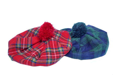 headgear: Traditional Scottish Green and Red Tartan Bonnet, also named Tam o Shanter. Men headgear Isolated on white Background.