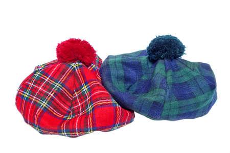 headgear: Traditional Scottish Green and Red Tartan Bonnet, also named Tam o Shanter. Men headgear Isolated on white Background.