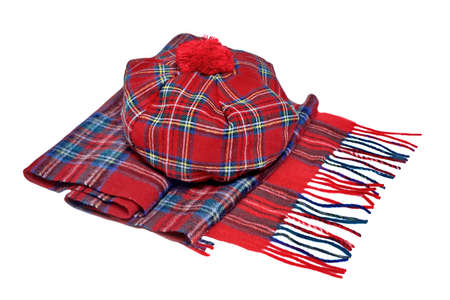 headgear: Traditional Scottish Red Tartan Bonnet and Scarf Men headgear and neckwear Isolated on white Background.