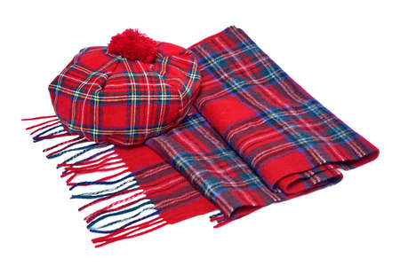 neckwear: Traditional Scottish Red Tartan Bonnet and Scarf Men headgear and neckwear Isolated on white Background.