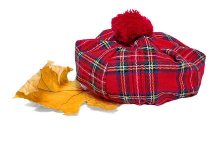 headgear: Traditional Scottish Red Tartan Bonnet, also named Tam o Shanter. Men headgear Isolated on white Background.
