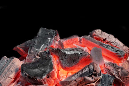 coals: Hot Charcoal in the BBQ Grill Pit Isolated on Black Background