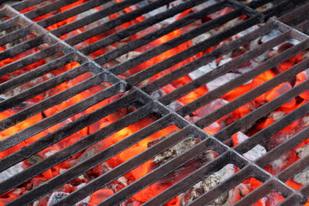 Empty BBQ Grill and Glowing Hot Coals.  Background with space for text or image.