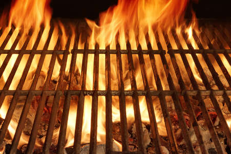 Burning Hot Fire in a  Barbecue with an Empty Grill