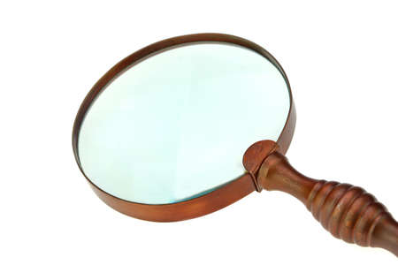 Vintage Brass Magnifying Glass Isolated on White Background photo