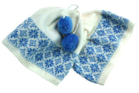 Close-up of White Knitted Winter Ski Wool Hat With Pom-Pom and Blue Jacquard Pattern Isolated on White Background photo