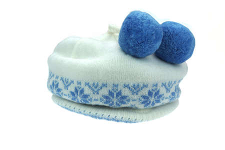 jacquard: Close-up of White Knitted Winter Ski Wool Hat With Pom-Pom and Blue Jacquard Pattern Isolated on White Background