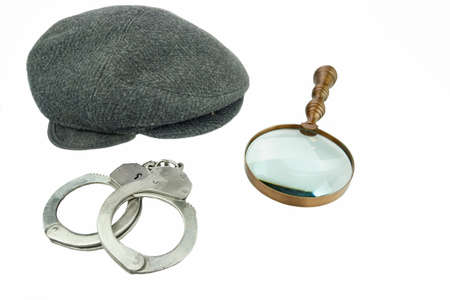 newsboy cap: Detective Warm Cap, Retro Magnifying Glass and Real Handcuffs Isolated on White Background