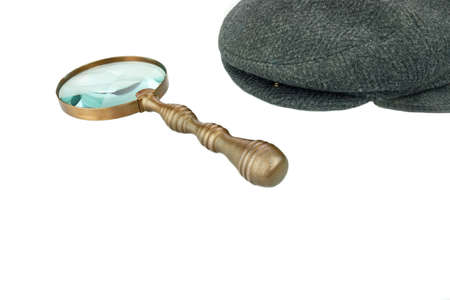 newsboy cap: Detective Warm Cap and Vintage Magnifying Glass Isolated on White Background Stock Photo