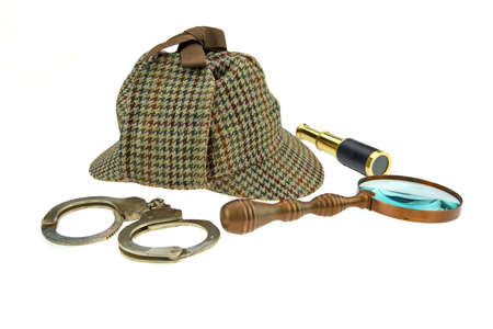 Deerstalker Hat, Retro Magnifier, Gold Spyglass and Real Handcuffs Isolated on White Background Reklamní fotografie