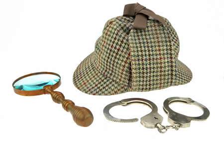 Detective Hat, Retro Magnifier and Real Handcuffs Isolated on White Background photo