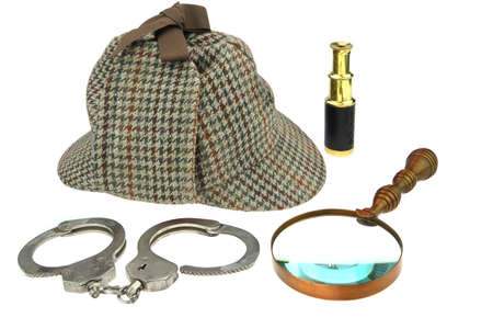 Deerstalker Hat, Retro Magnifier, Gold Spyglass and Real Handcuffs Isolated on White Background photo