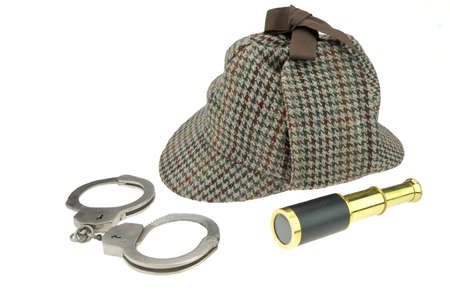 Deerstalker Hat, Real Handcuffs and Retro Spyglass  Isolated on White Background photo