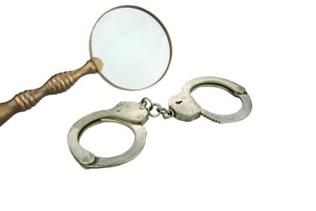 manacle: Retro Magnifying Glass and Handcuffs isolated on White Background