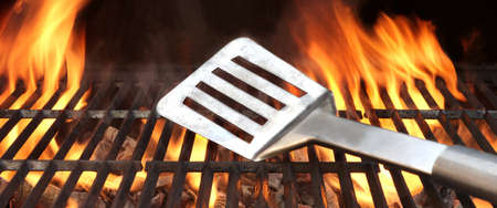 barbecue: Spatula on the Barbecue Charcoal Fire Grill with Black Background