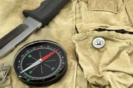 wander: Hunting Knife with Rubberized  Handle and Compass on the Camouflage Bag