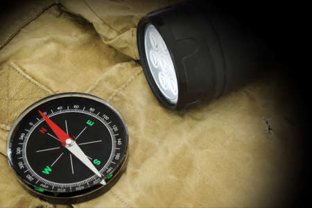 limelight: Searchlight and Compass on Backpack.  Stock Photo