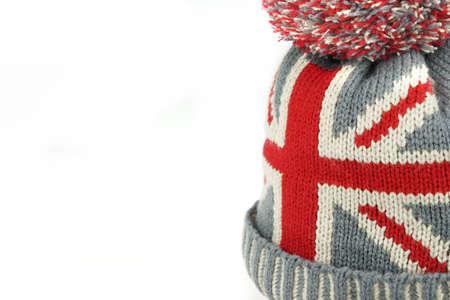 scottish female: Single Winter Knitted Wool Ski Hat With Union Jack Flag Isolated On White Background Close-Up