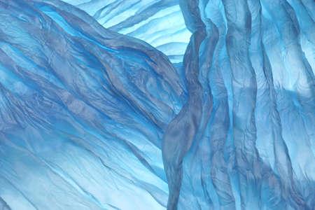 Blue Wavy Aquamarine Fabric Texture Background Close-up photo