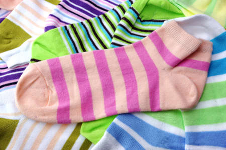 stripe pattern: Stack Of Many Pairs of Colorful Striped Socks isolated On White Background Stock Photo