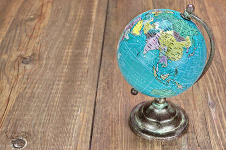 Vintage World Geographical Globe On The Wood Table. Asia and Arabia Countries Close-up