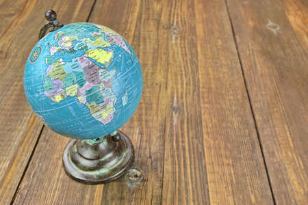 geography map: Vintage World Geographical Globe On The Wood Table. Africa Continent Close-up