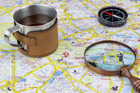 London Map And Traveler Vacation or Adventure Items. Magnifying Glass, Compass And Notes photo