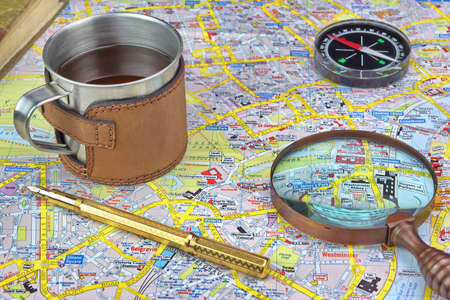 London Map And Travel Items. Magnifying Glass, Compass, Notes and Gold Fountain Pen photo