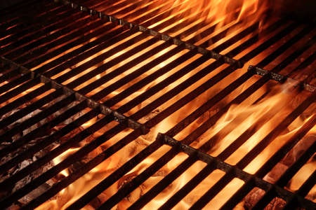 Empty Hot Barbecue Grill With Flames and Copy Space. Picnic or Party or Cookout Background Stock Photo