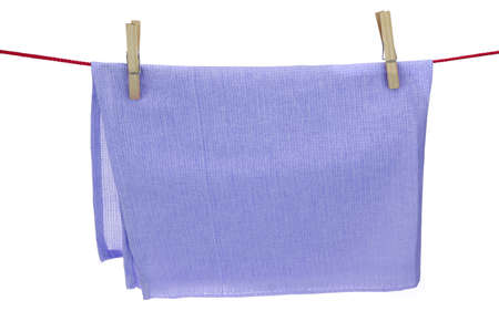 hand towel: Clean Dry Violet Textured Towel Hanging On A Red Rope  Isolated On A White Background With Copy Space. You can use this image as signboard.