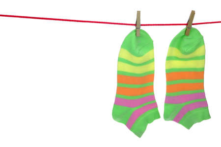 Hanging Striped Socks  Isolated On White Background photo