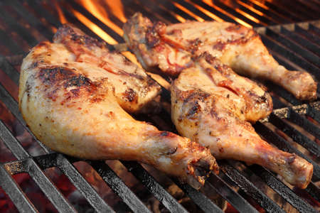 Marinated Chicken Legs Fried On The Hot Flaming BBQ Grill. Charcoal Flames On the Background. Stock Photo - 39122919