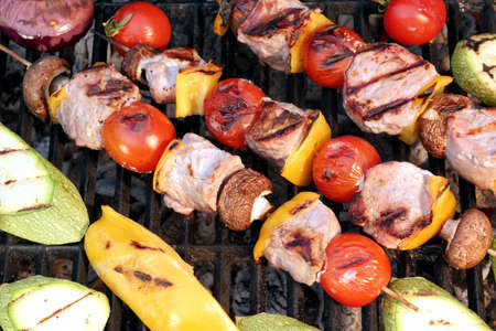 kebob: Meat And Vegetables Shish Kabobs On The Charcoal Grill Close-up Background