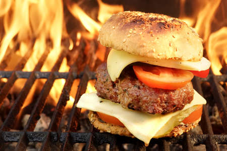 burger: Homemade BBQ Beef Burger On The Hot Flaming Grill. Good Snack For Outdoors Summer Party Or Picnic