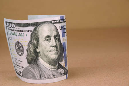 one hundred dollar bill: New One Hundred USA Dollar Bill On The Rough Paper Background