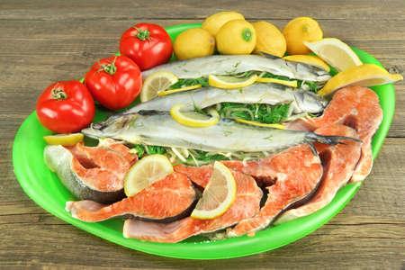 stuffed fish: Large Dish With Fresh  Stuffed Fish Salmon Steaks,  Lemon Slice And Herbs