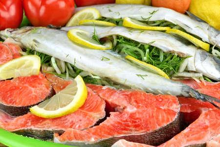 redfish: Large Dish With Fresh  Stuffed Fish Salmon Steaks,  Lemon Slice And Herbs