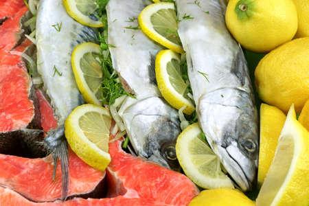 Dish With Fresh  Stuffed Fish Salmon Steaks,  Lemon Slice And Herbs Close-up Background photo