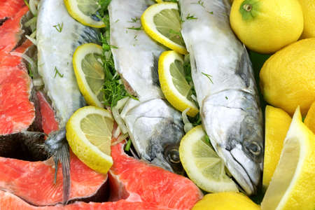 stuffed fish: Dish With Fresh  Stuffed Fish Salmon Steaks,  Lemon Slice And Herbs Close-up Background