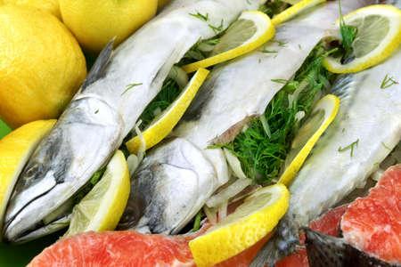 stuffed fish: Dish With Fresh  Stuffed Fish Salmon Steaks,  Lemon Slice And Herbs Close-up Background