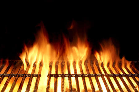 meat on grill: Empty Flaming Charcoal Grill  With Flames Of Fire On Black Background Closeup. Summer Outdoor Barbeque Party or Picnic Concept. Stock Photo