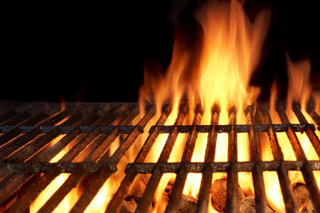flame: Empty Flaming Charcoal Grill  With Flames Of Fire On Black Background Closeup. Summer Outdoor Barbeque Party or Picnic Concept. Stock Photo