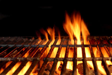 briquettes: Empty Flaming Charcoal Grill  With Flames Of Fire On Black Background Closeup. Summer Outdoor Barbeque Party or Picnic Concept. Stock Photo