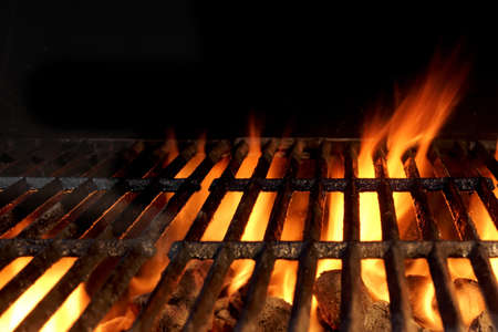 grill: Empty Hot Charcoal Grill With Flames Of Fire On Black Background Closeup