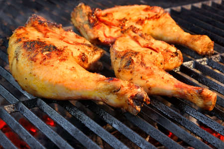 hot legs: Marinated Chicken Legs On  The Hot BBQ Charcoal Grill. Good Snack For Outdoor Weekend Party or Picnic
