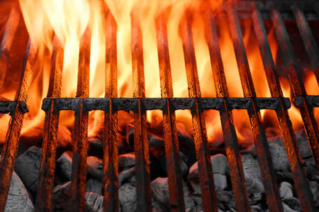 grill: Empty Hot Charcoal Barbecue Grill With Bright Flame On The Black Background