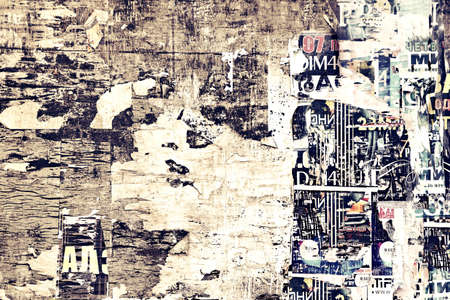 urban street: Old Weathered Wood Billboard with Torn Posters Background Texture
